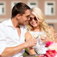 couple drinking wine outside