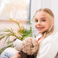 6 year old girl with teddy bear