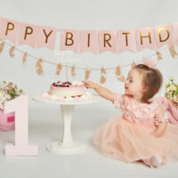 1 year old girl with birthday cake