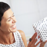 Middle aged woman with a gift