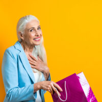 older woman holding gift